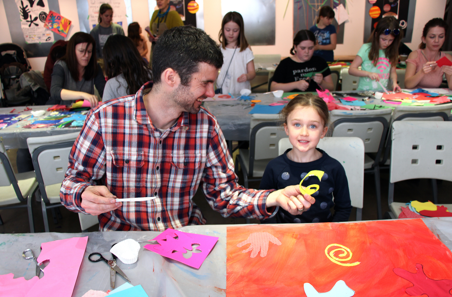 Families participating in art workshop at the MacLaren Art Centre