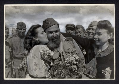 Unidentified Photographer, Meeting the demobilized veterans at the Rzhev Station, Moscow, July, 1945, gelatin silver print.