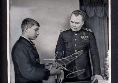 E. Evzerikhin, Air Marshal K. Vershinin, Commander of the Air Forces of the Soviet Union, and Vladimir Kuzhanin, a Moscow school boy and a prominent aircraft-model builder who has set a series of records in this field, January, 1948, gelatin silver print.