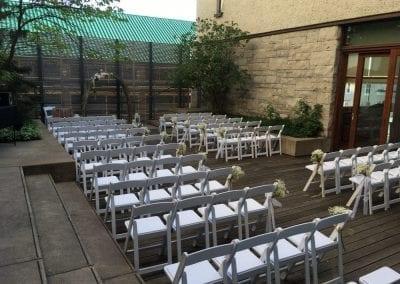 Wedding ceremony decor in the courtyard patio of the MacLaren Art Centre