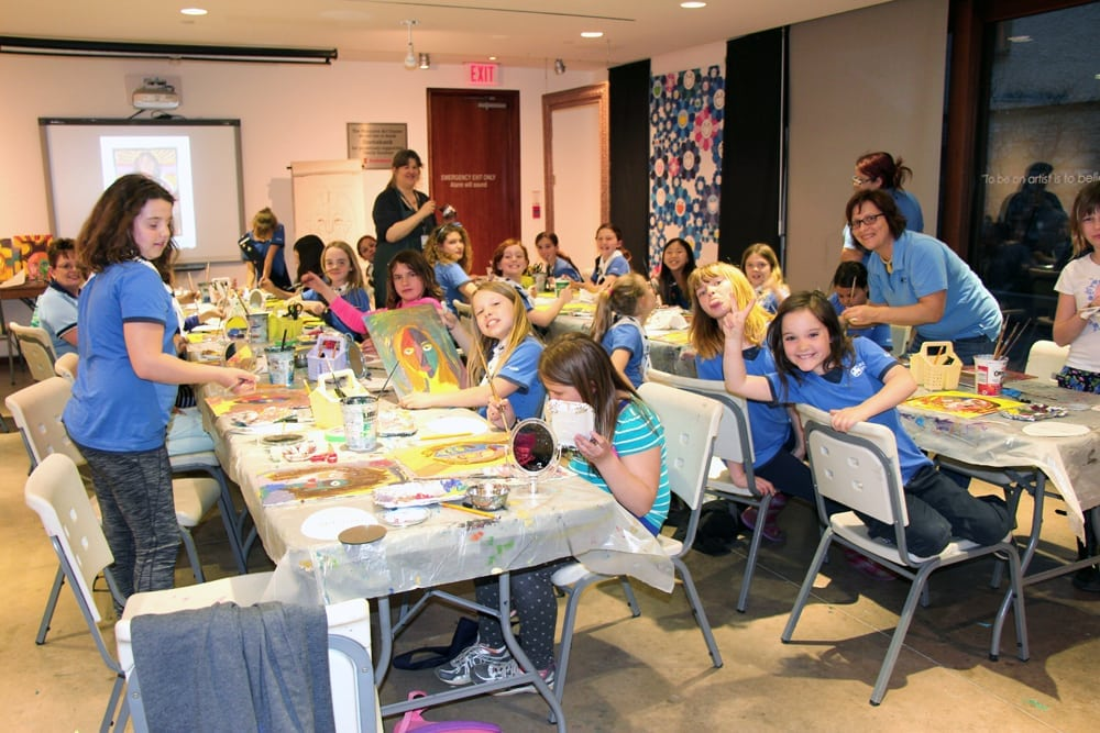 Girl guides tour group making art at the MacLaren Art Centre