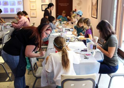 Families participating in an art workshop at the MacLaren Art Centre