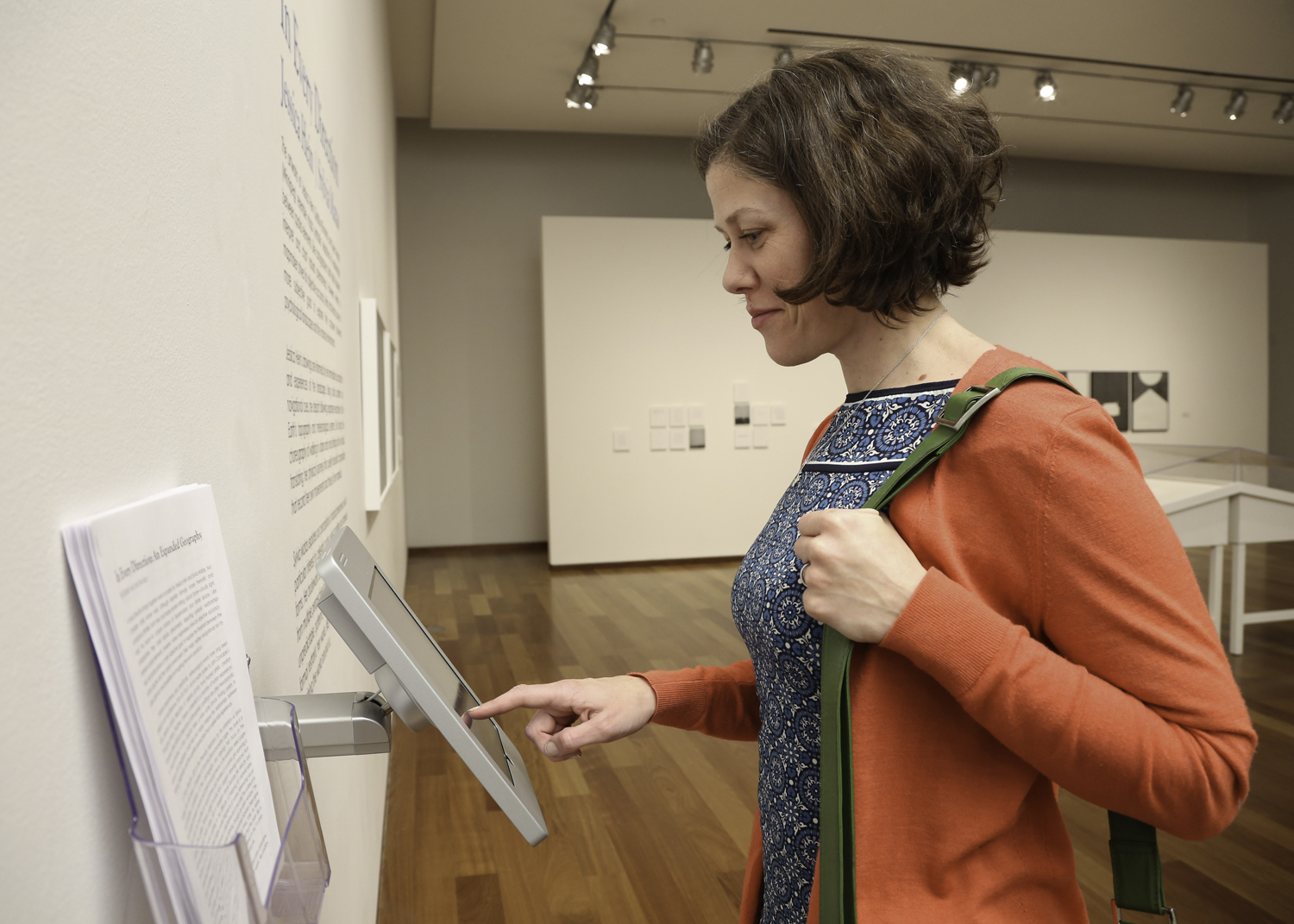Woman using iPad in an exhibition at the MacLaren Art Centre