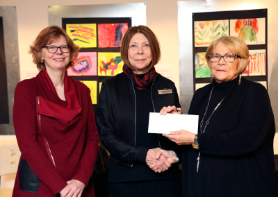 Cheque presentation at the opening reception of the Art Explorers winter exhibition with the May Court Club of Barrie
