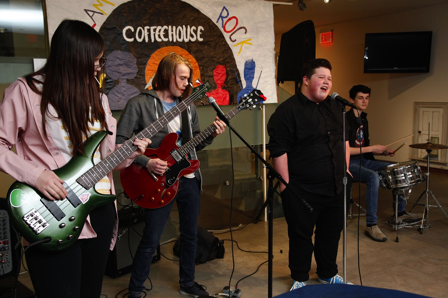 Youth music group performing at the Glam Rock Spring Coffeehouse at the MacLaren Art Centre