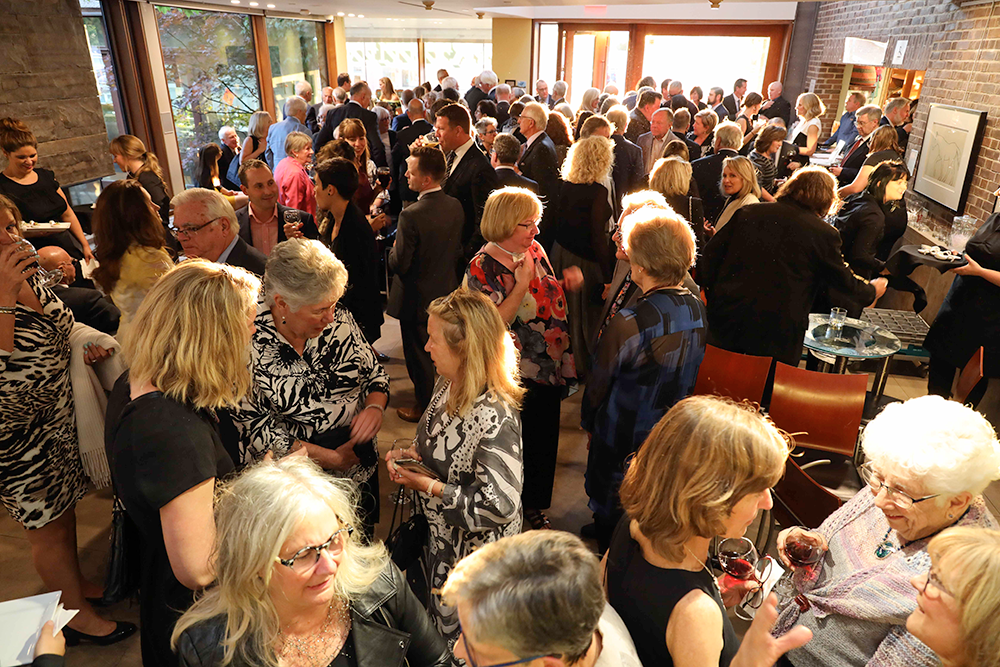 Large crowd gathered in the MacLaren Art Centre lobby for a reception