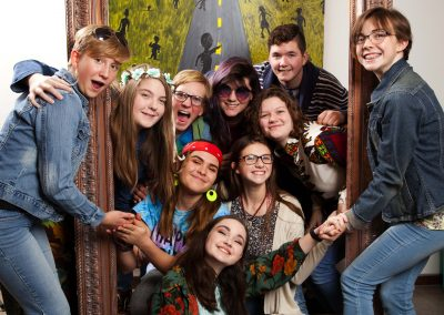 Youth taking group picture in photo booth at the Youth Halloween Coffeehouse