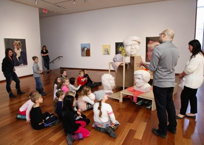 Class of children on exhibition tour at the MacLaren Art Centre