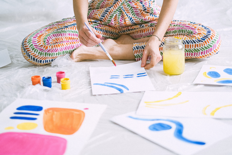 Child painting with watercolour paints
