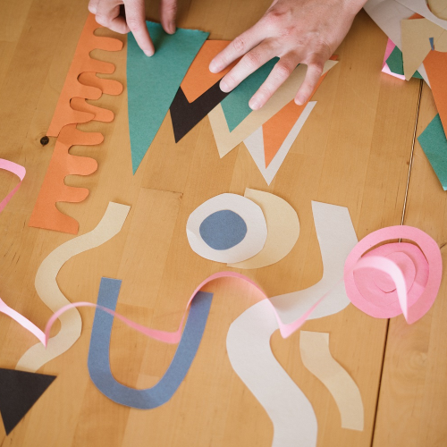 Assorted paper shapes on a table