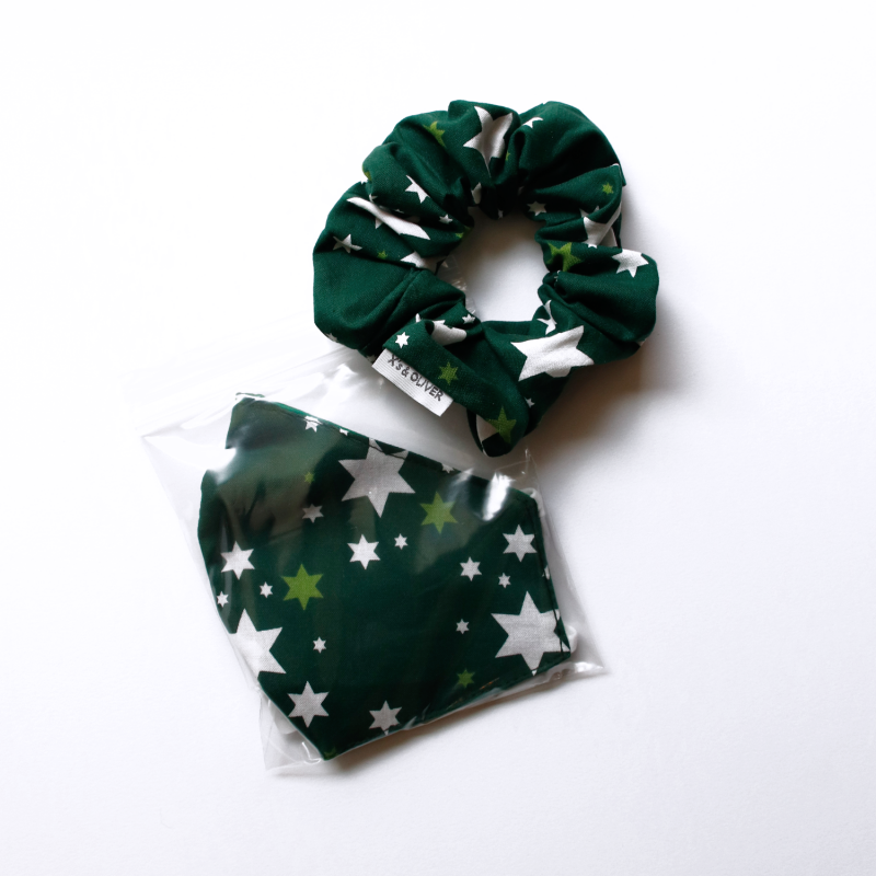 Matching mask and scrunchie set, dark green fabris with a star pattern from the Gallery Shop holiday collection.