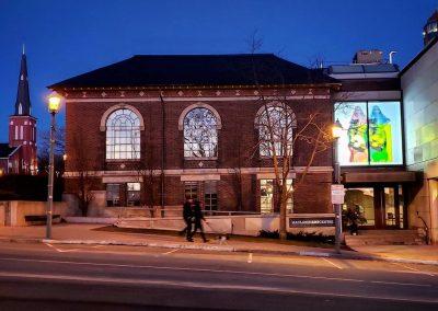 Art projection onto a window of the MacLaren Art Centre