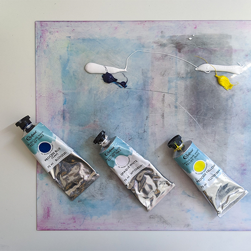 tubes of paint on a printmaking plate
