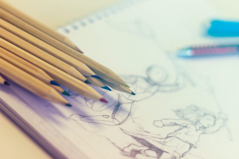 Drawing pencils and a sketchbook